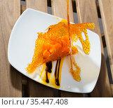Close up of tasty dessert of sweet carrots cubes with caramel and vanilla sauce. Стоковое фото, фотограф Яков Филимонов / Фотобанк Лори