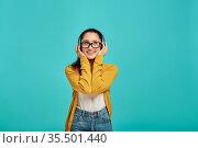 Woman in headphones listens to music, emotion. Стоковое фото, фотограф Tryapitsyn Sergiy / Фотобанк Лори