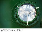 Round frontal headlight of an old green locomotive. Стоковое фото, фотограф EugeneSergeev / Фотобанк Лори