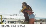 Happy caucasian couple hugging near beach buggy by the sea. Стоковое видео, агентство Wavebreak Media / Фотобанк Лори