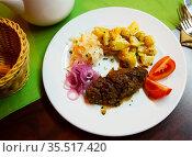 Plate with a meat dish lula-kebab and stewed potatoes. Стоковое фото, фотограф Яков Филимонов / Фотобанк Лори