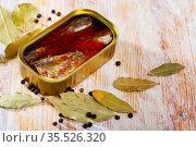 Open tin can of spicy sardines in aluminium can. Стоковое фото, фотограф Яков Филимонов / Фотобанк Лори
