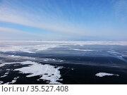 Frozen icy surface of the Baikal lake in February day. Стоковое фото, фотограф Алексей Кузнецов / Фотобанк Лори