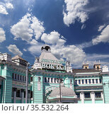 Belorusskiy railway station (written in Russian)-- is one of the nine main railway stations in Moscow, Russia. It was opened in 1870 and rebuilt in its current form in 1907-1912 (2016 год). Редакционное фото, фотограф Владимир Журавлев / Фотобанк Лори
