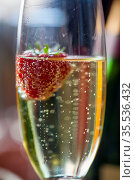 Glas of sparkling wine or champagne and strawberry on a blurry background... Стоковое фото, фотограф Zoonar.com/Photo Luna Nathalie Schatteman / easy Fotostock / Фотобанк Лори