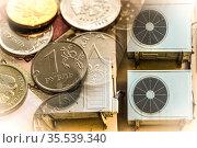 Кондиционеры ( устройства для поддержания заданной температуры ) на фоне денег. Стоковое фото, фотограф Сергеев Валерий / Фотобанк Лори
