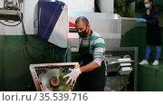 Winery workers in protective masks control the wine production process. Стоковое видео, видеограф Яков Филимонов / Фотобанк Лори