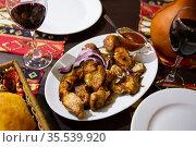 Appetizing pork shish kebab of Georgian cuisine with adzhika and onion. Стоковое фото, фотограф Яков Филимонов / Фотобанк Лори