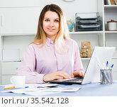 Smiling female manager working effectively. Стоковое фото, фотограф Яков Филимонов / Фотобанк Лори