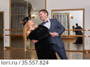 Couple of amateur dancers dancing tango with each other and laughing. Стоковое фото, фотограф Евгений Харитонов / Фотобанк Лори
