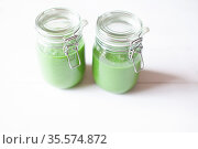 Healthy green smoothie in a glass jar on a white wooden background. Стоковое фото, фотограф Zoonar.com/Photographer: Nathalie Schatteman / easy Fotostock / Фотобанк Лори