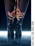 Sexy stripper legs, bdsm show, dark background. Стоковое фото, фотограф Tryapitsyn Sergiy / Фотобанк Лори