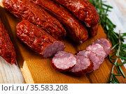 Roasted chezh sausages susena on cutting board. Стоковое фото, фотограф Яков Филимонов / Фотобанк Лори