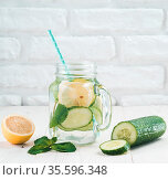 Infused detox water with cucumber, lemon and mint in mason jar on... Стоковое фото, фотограф Zoonar.com/Olga Sergeeva / easy Fotostock / Фотобанк Лори