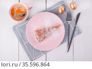 A piece of pie on a pink plate with a knife and fork on a folded linen napkin. Стоковое фото, фотограф Ольга Губская / Фотобанк Лори