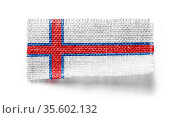 Faroe Islands flag on a piece of cloth on a white background. Стоковое фото, фотограф Zoonar.com/BUTENKOV ALEKSEY / easy Fotostock / Фотобанк Лори