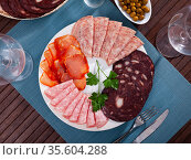 Delicious Spanish antipasto platter with various meat. Стоковое фото, фотограф Яков Филимонов / Фотобанк Лори