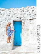 Little adorable girl in dress outdoors in old streets an Mykonos. Стоковое фото, фотограф Дмитрий Травников / Фотобанк Лори