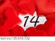 Valentine's day red silk hearts on calendar with 14 february date... Стоковое фото, фотограф Zoonar.com/Ivan Mikhaylov / easy Fotostock / Фотобанк Лори