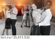 Young people learning to technique of classical dance in dancing class. Стоковое фото, фотограф Яков Филимонов / Фотобанк Лори