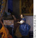 Johannes Vermeer (1632-1674) Dutch painter,  Zittende Klavecimbelspeelster... Редакционное фото, агентство World History Archive / Фотобанк Лори