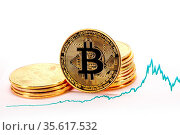 Graph chart of exchange rates of virtual money bitcoin and pile of... Стоковое фото, фотограф Zoonar.com/Ivan Mikhaylov / easy Fotostock / Фотобанк Лори