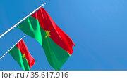 3D rendering of the national flag of Burkina Faso waving in the wind... Стоковое фото, фотограф Zoonar.com/Aleksey Butenkov / easy Fotostock / Фотобанк Лори