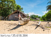 Traditional pirogue in a fishing village on the shore of Nosy Be island... Стоковое фото, фотограф Valeriy Tretyakov / easy Fotostock / Фотобанк Лори