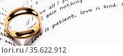 Golden wedding ring Love is Patient and Kind concept. Стоковое фото, фотограф Zoonar.com/Ivan Mikhaylov / easy Fotostock / Фотобанк Лори