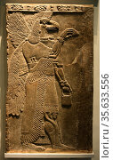 Eagle-headed protective spirit. Assyrian, about 865-860 BC From Nimrud... Редакционное фото, агентство World History Archive / Фотобанк Лори