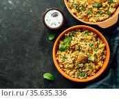 Pakistani chicken biryani rice, topview copy space. Стоковое фото, фотограф Ольга Сергеева / Фотобанк Лори