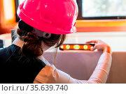 Construction quality control. close up rear view of a woman architect... Стоковое фото, фотограф Zoonar.com/VALMEDIA / easy Fotostock / Фотобанк Лори