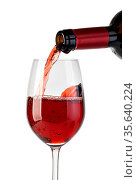 Red wine pouring in glass, isolated on white. Стоковое фото, фотограф Zoonar.com/Serghei Platonov / easy Fotostock / Фотобанк Лори