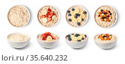 Prepared oatmeal with fruits and berries isolated on white background. Стоковое фото, фотограф Zoonar.com/Serghei Platonov / easy Fotostock / Фотобанк Лори