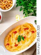 Hummus paste with lemon and chilli on white background. Стоковое фото, фотограф Zoonar.com/Darius Dzinnik / easy Fotostock / Фотобанк Лори