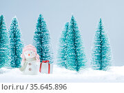 Small cute snowman with gift in forest in snow cute Christmas card... Стоковое фото, фотограф Zoonar.com/Ivan Mikhaylov / easy Fotostock / Фотобанк Лори