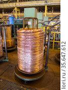 Copper wire rolled up in big bobbin nonferrous metal industry. Стоковое фото, фотограф Кекяляйнен Андрей / Фотобанк Лори