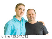 Father and son, standing with their arms around each other and looking at the camera. Стоковое фото, фотограф Владимир Ушаров / Фотобанк Лори