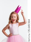 Funny princess girl in pink dress and crown with finger up isolated... Стоковое фото, фотограф Zoonar.com/Ivan Mikhaylov / easy Fotostock / Фотобанк Лори