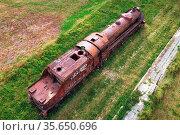 Old train cemetery. Aerial view of an old abandoned rusty steam train... Стоковое фото, фотограф Zoonar.com/DAVID HERRAEZ CALZADA / easy Fotostock / Фотобанк Лори