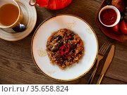 Pilau with lamb meat garnished with red hot pepper. Стоковое фото, фотограф Яков Филимонов / Фотобанк Лори