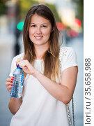 Woman drinking water from bottle. Стоковое фото, фотограф Яков Филимонов / Фотобанк Лори
