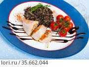 Stuffed squid with bell peppers, eggs, wild rice and greens. Стоковое фото, фотограф Яков Филимонов / Фотобанк Лори
