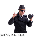 Spy with camera taking pictures isolated on white. Стоковое фото, фотограф Elnur / Фотобанк Лори