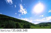 4K UHD mountain meadow timelapse at the summer. Clouds, trees, green grass and sun rays movement. Стоковое видео, видеограф Александр Маркин / Фотобанк Лори