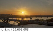 Timelapse of city life. Sun rays, blue sky, river and bridge over horizont. Traffic jam at summer sunset time. Motorised slider movement. Стоковое видео, видеограф Александр Маркин / Фотобанк Лори