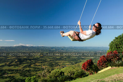 Young woman swinging on a swing at Montana Redonda