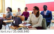 Attentive students at their desks in the university auditorium. Стоковое видео, видеограф Яков Филимонов / Фотобанк Лори