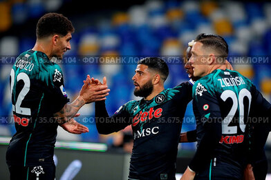Lorenzo Insigne (Napoli) celebrates with teammates during the match...