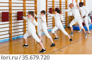 Cheerful group of athletes at fencing workout. Стоковое фото, фотограф Яков Филимонов / Фотобанк Лори